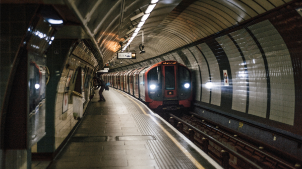 Tube train pulling into an Underground platform