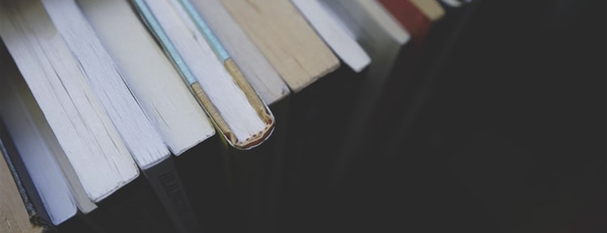 Close up of the top of a stack of books
