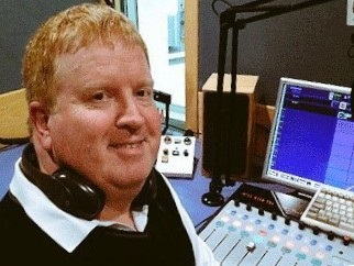 Roger Cole, presenter of RNIB's Connect Radio show, sat in front of his computer