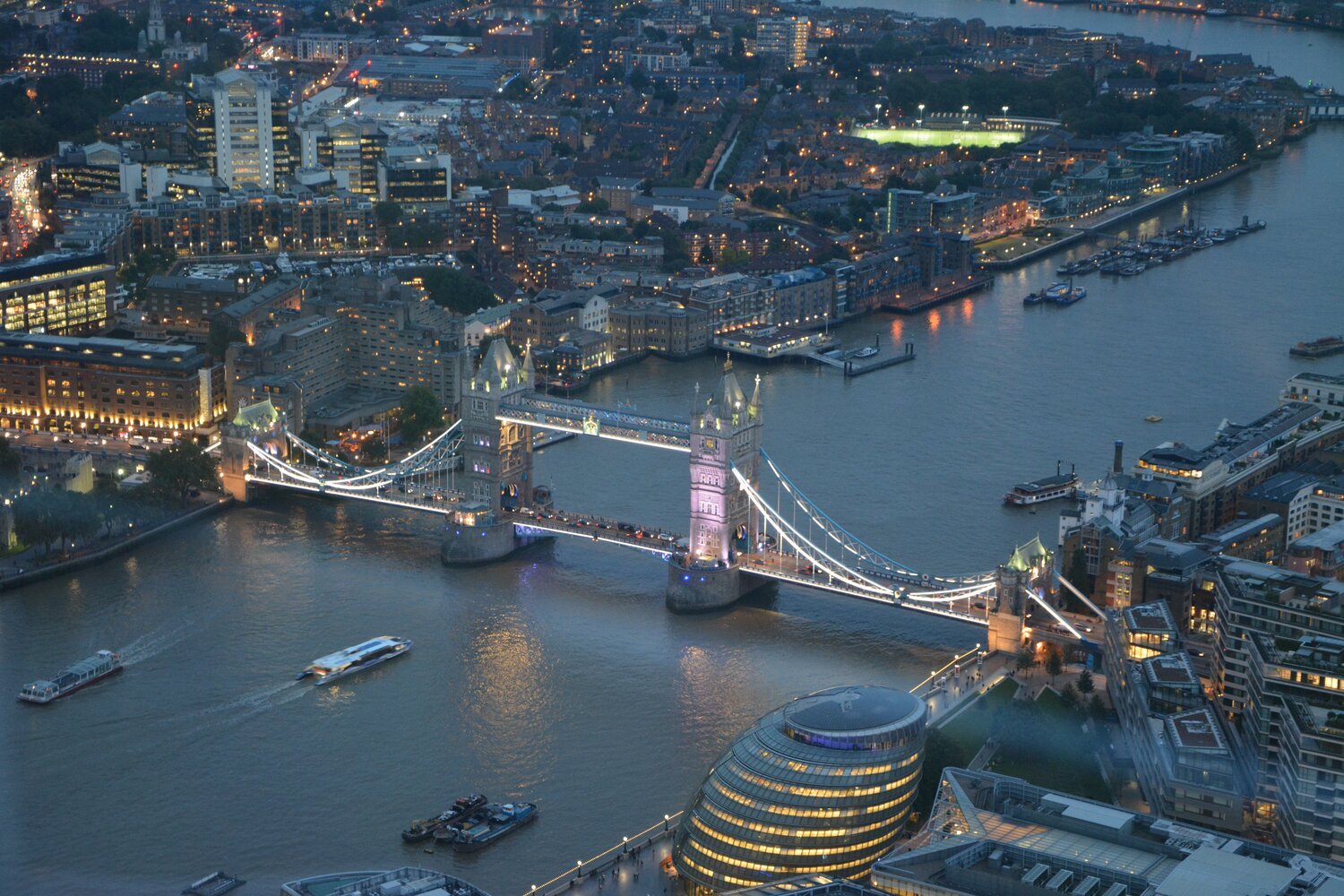 Tower Bridge and London's City Hall by night