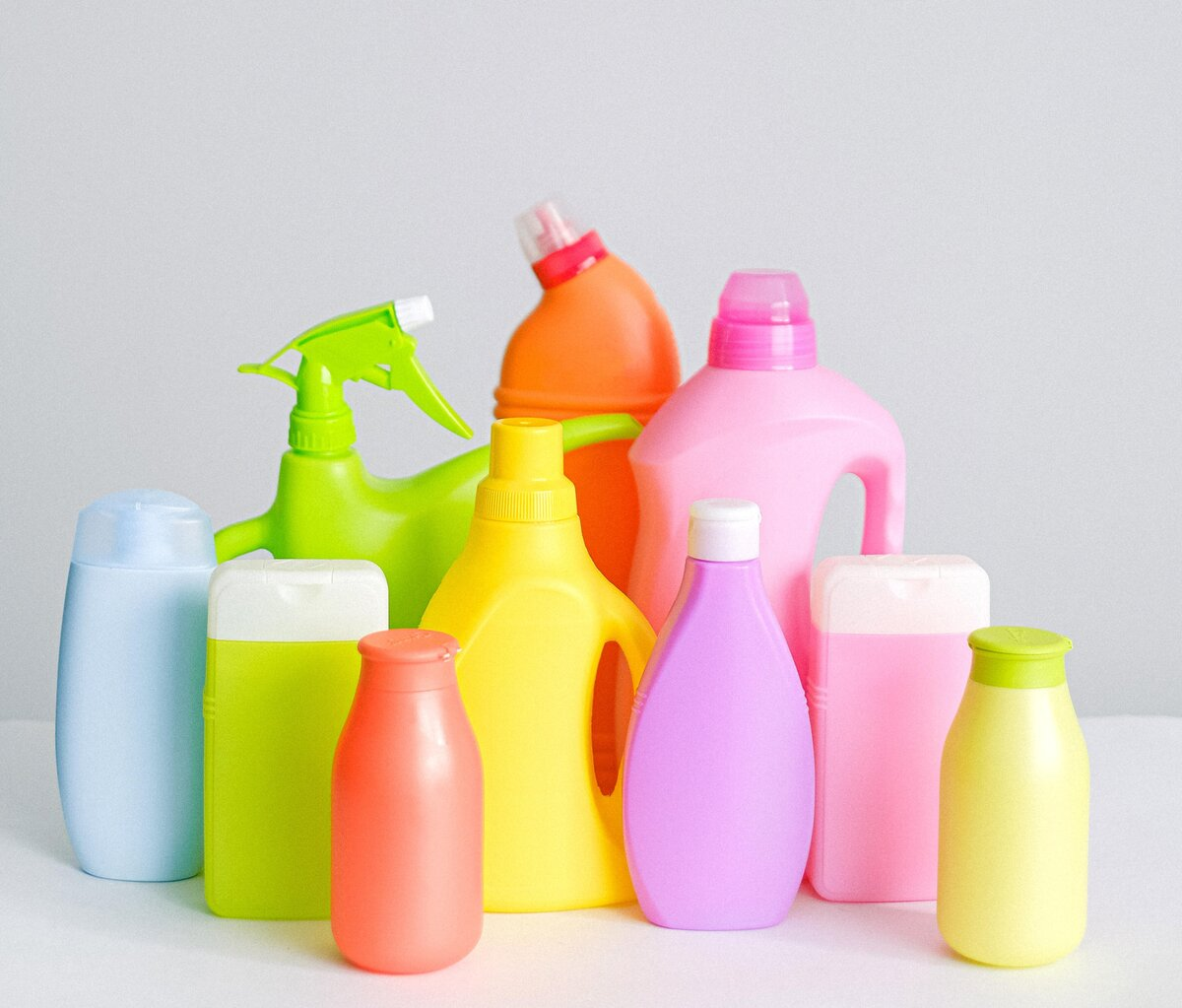 A selection of brightly coloured plastic cleaning fluid containers